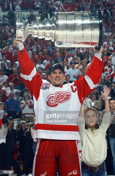 Steve Yzerman of the Detroit Red Wings raises the Stanley Cup after defeating the Carolina Hurricanes during game five of the NHL Stanley Cup Finals...