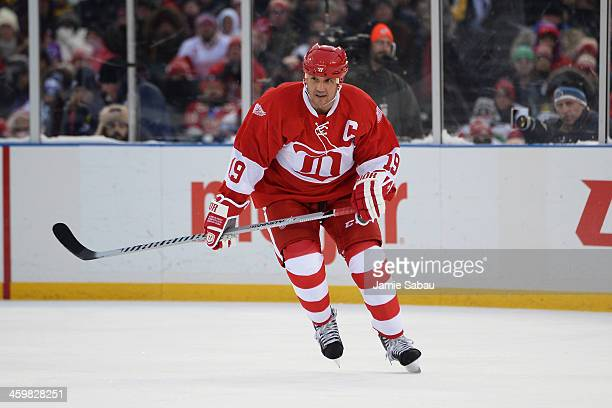Steve Yzerman of the Detroit Red Wings skates in the first period against the Toronto Maple Leafs during the 2013 Hockeytown Winter Festival Alumni...