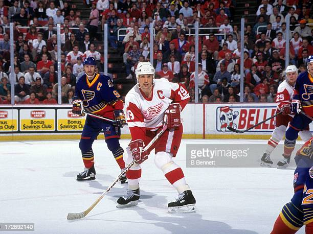 Steve Yzerman of the Detroit Red Wings skates on the ice as he is defended by Wayne Gretzky of the St Louis Blues during Game 7 of the 1996...
