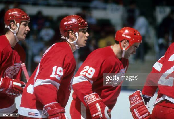 Steve Yzerman of the Detroit Red Wings skates on the ice with his teammates during an NHL game against the New York Islanders on February 21 1989 at...