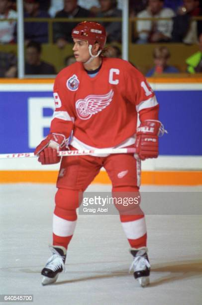 Steve Yzerman of the Detroit Red Wings watches the play develop against the Toronto Maple Leafs on October 31 1992 at Maple Leaf Gardens in Toronto...