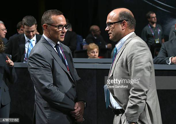 Steve Yzerman of the Tampa Bay Lightning and GM Peter Chiarelli of the Edmonton Oilers talk on the draft floor during the 2015 NHL Draft at BBT...