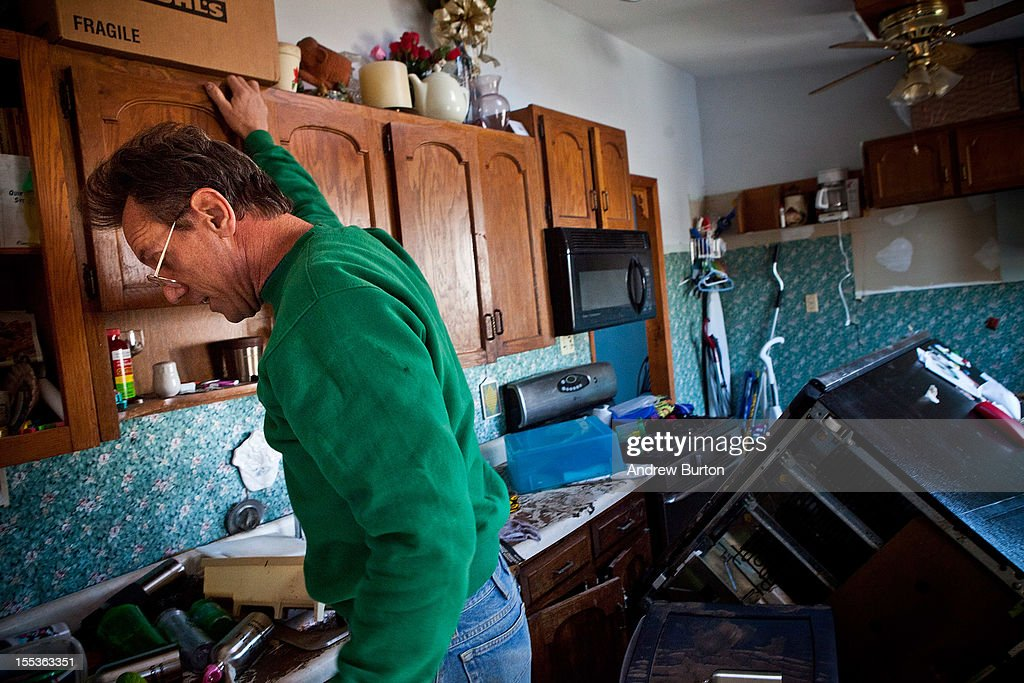 Steve Zboinski searches his house for valuables worth saving in the Midland Beach neighborhood of Staten Island on November 3, 2012 in New York City. As clean up efforts from Superstorm Sandy continue, colder weather and another storm predicted for next week are beginning to make some worried.