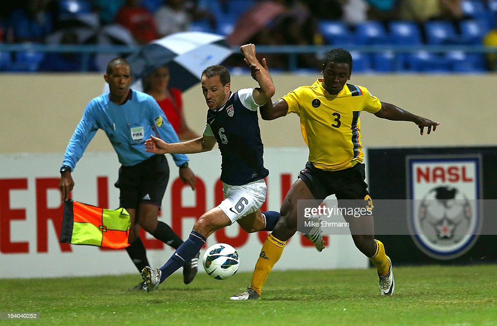 SteveCherundolo #6 of the United States fights for a ball against Zaine Francis-Angol #3 of Antigua and Barbuda during a World Cup Qualifying game at Sir Vivian Richards Stadium on October 12, 2012 in Antigua, Antigua and Barbuda.