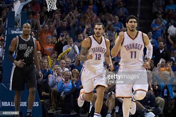 Steven Adams and Enes Kanter of the Oklahoma City Thunder run down the court during the fourth quarter of a NBA game against the San Antonio Spurs at...