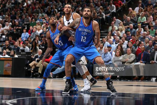 Steven Adams and Paul George of the Oklahoma City Thunder boxes out against Rudy Gobert of the Utah Jazz on October 21 2017 at Vivint Smart Home...