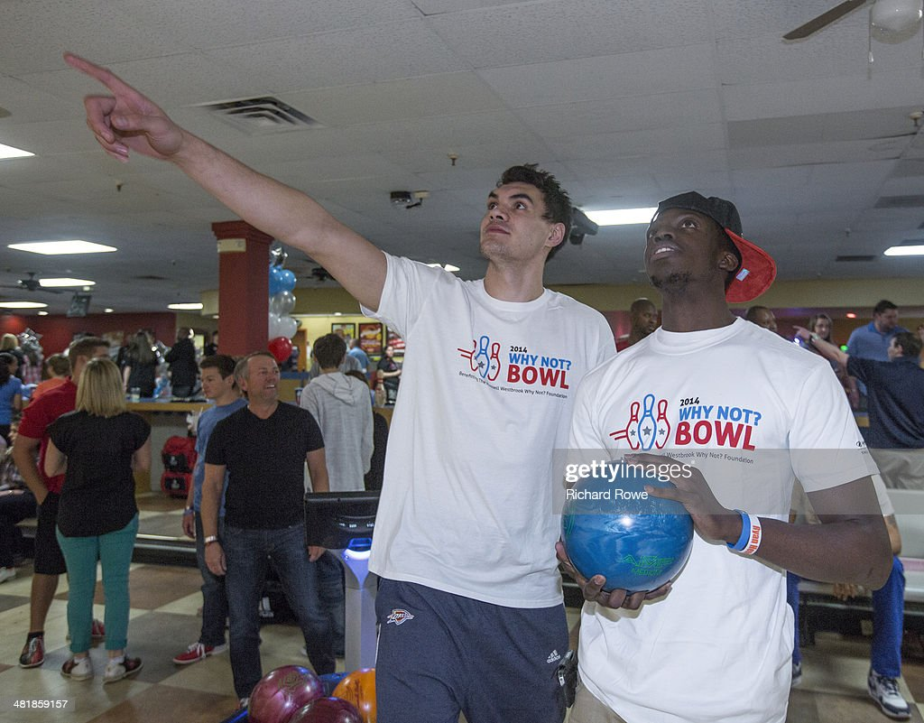 Steven Adams #12 and Reggie Jackson #15 joins Russell Westbrook #0 of the Oklahoma City Thunder at his annual Why Not Foundation fundraiser to benefit the Boys and Girls Club at AMC Boulevard Bowl in Edmond, Oklahoma.