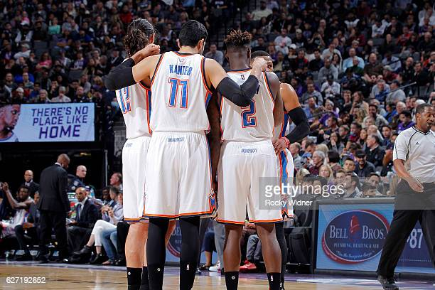 Steven Adams Enes Kanter and Anthony Morrow of the Oklahoma City Thunder huddle up during the game against the Sacramento Kings on November 23 2016...