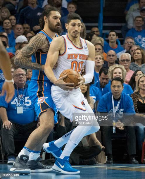 Steven Adams of the Oklahoma City Thunder and Enes Kanter of the New York Knicks fight for the ball during the first half of a NBA game at the...