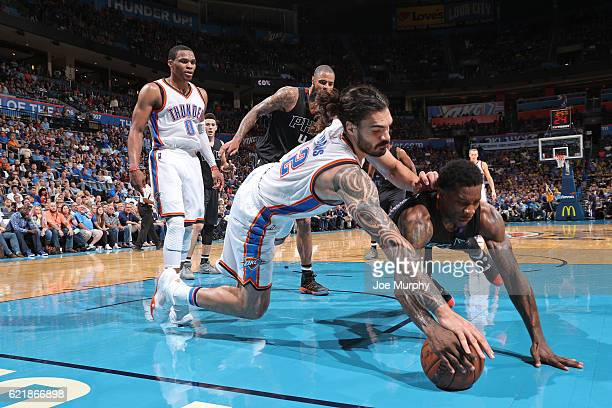 Steven Adams of the Oklahoma City Thunder and Eric Bledsoe of the Phoenix Suns chase after a loose ball on October 28 2016 at the Chesapeake Energy...