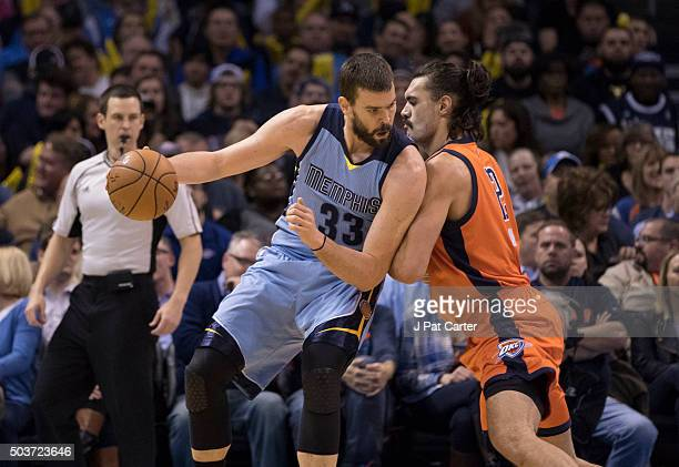Steven Adams of the Oklahoma City Thunder applies pressure as Marc Gasol of the Memphis Grizzlies looks for a play during the first quarter of a NBA...