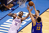 Steven Adams of the Oklahoma City Thunder battles for the rebound with Andrew Bogut of the Golden State Warriors during the first half in game six of...