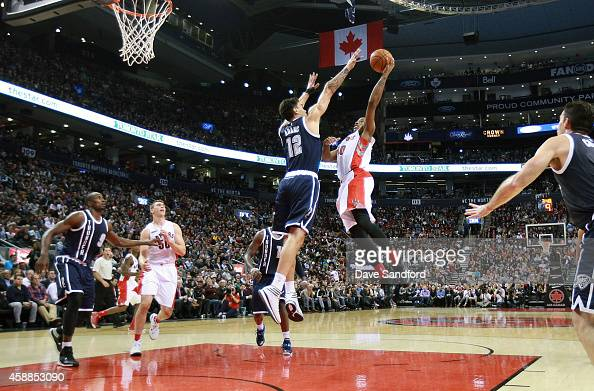 Steven Adams of the Oklahoma City Thunder defends as DeMar DeRozan of the Toronto Raptors drives to the basket during their game at Air Canada Centre...