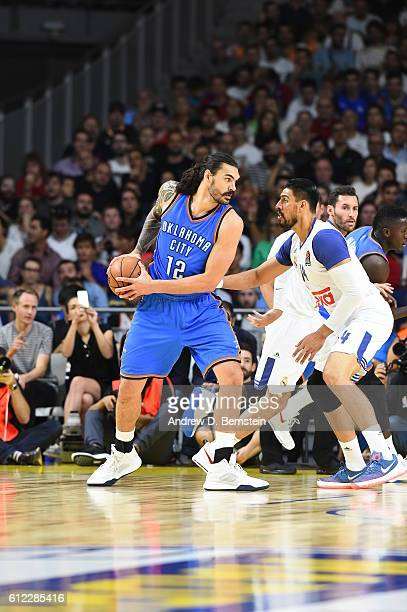 Steven Adams of the Oklahoma City Thunder dribbles against Real Madrid as part of the 2016 Global Games on October 3 2016 at the Barclaycard Center...