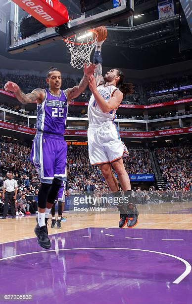 Steven Adams of the Oklahoma City Thunder dunks against Matt Barnes of the Sacramento Kings on November 23 2016 at Golden 1 Center in Sacramento...