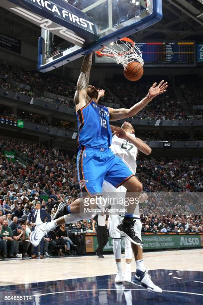 Steven Adams of the Oklahoma City Thunder dunks against the Utah Jazz during the game on October 21 2017 at vivintSmartHome Arena in Salt Lake City...