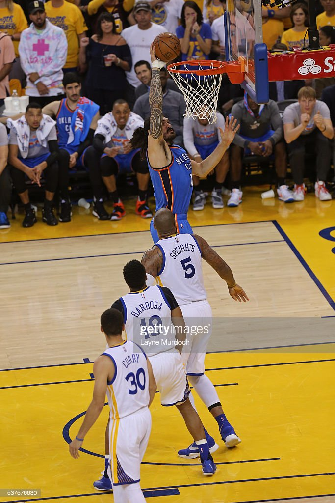 Steven Adams #12 of the Oklahoma City Thunder dunks the ball against the Golden State Warriors in Game Five of the Western Conference Finals during the 2016 NBA Playoffs on May 26, 2016 at ORACLE Arena in Oakland, California.