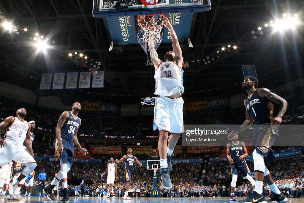 Steven Adams #12 of the Oklahoma City Thunder dunks the ball during the game against the New Orleans Pelicans during a preseason game on October 6, 2017 at Chesapeake Energy Arena in Oklahoma City, Oklahoma.