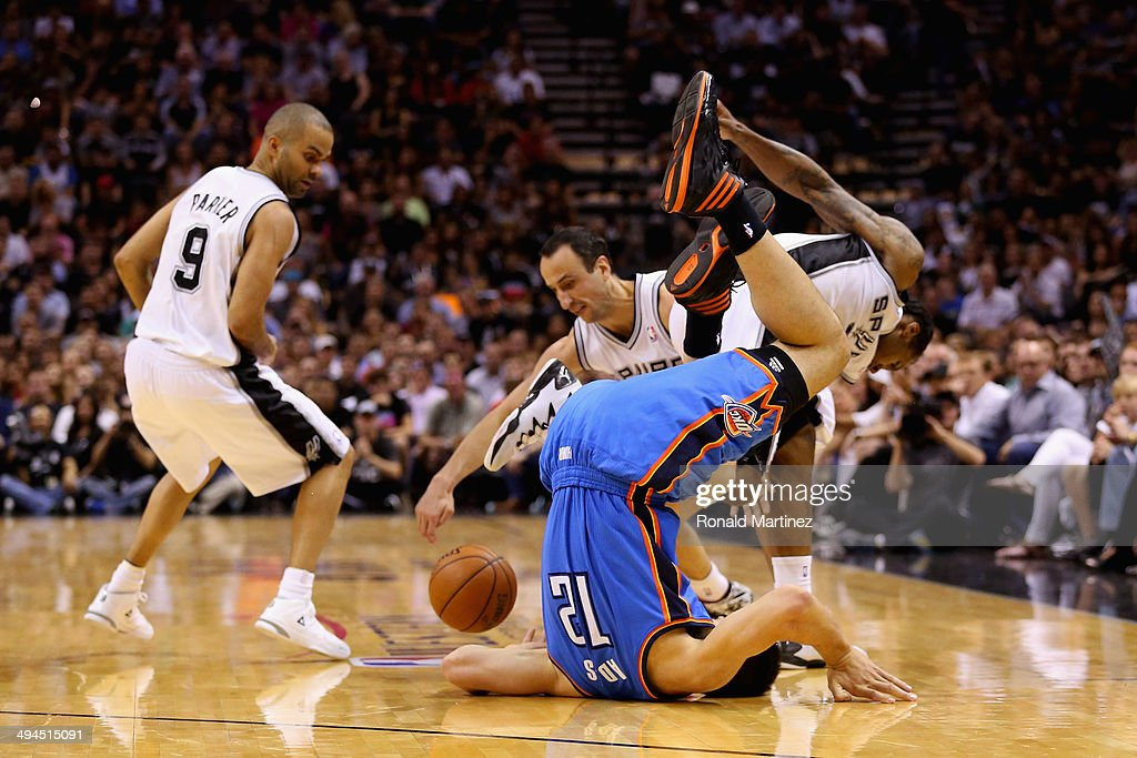 Steven Adams #12 of the Oklahoma City Thunder flips over while going for a loose ball against Tony Parker #9, Manu Ginobili #20 and Kawhi Leonard #2 of the San Antonio Spurs in the second half during Game Five of the Western Conference Finals of the 2014 NBA Playoffs at AT&T Center on May 29, 2014 in San Antonio, Texas.