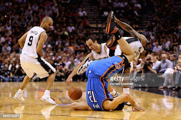 Steven Adams of the Oklahoma City Thunder flips over while going for a loose ball against Tony Parker Manu Ginobili and Kawhi Leonard of the San...