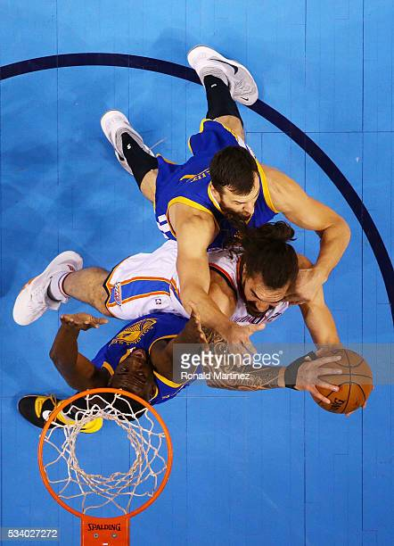 Steven Adams of the Oklahoma City Thunder goes up against Andrew Bogut and Draymond Green of the Golden State Warriors in the first quater in game...