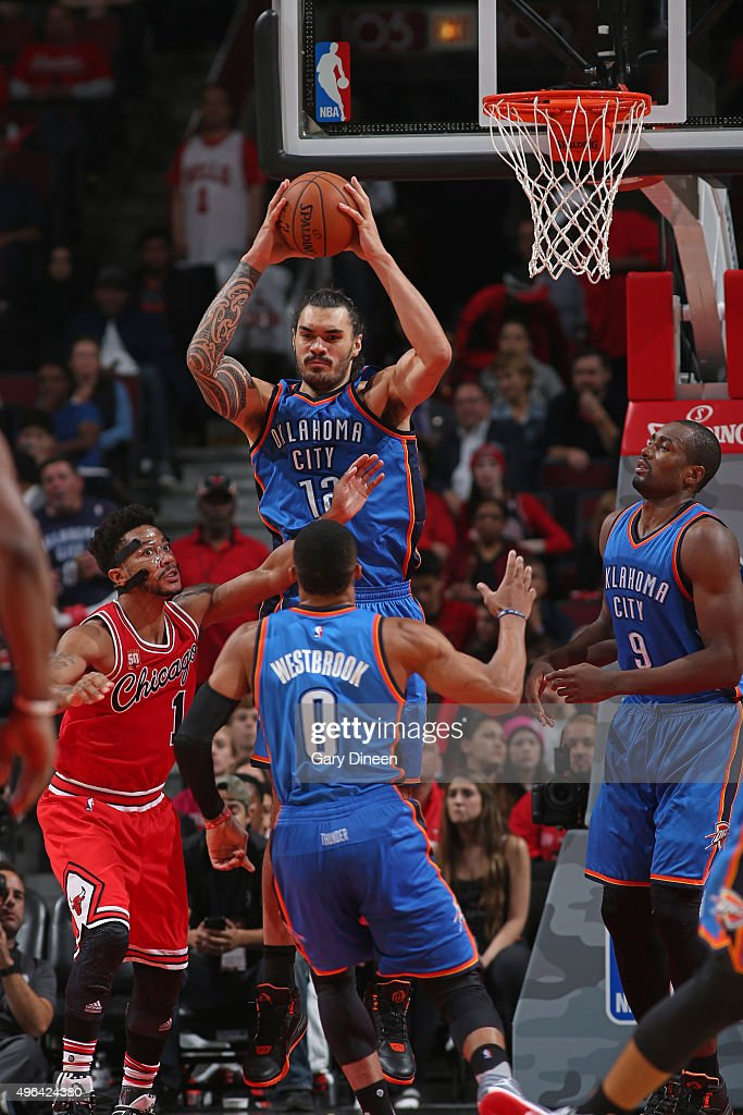 Steven Adams #12 of the Oklahoma City Thunder grabs the rebound against the Chicago Bulls on November 5, 2015 at the United Center in Chicago, Illinois.