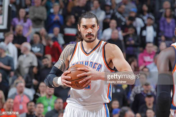 Steven Adams of the Oklahoma City Thunder holds onto the ball during the game against the Sacramento Kings on November 23 2016 at Golden 1 Center in...