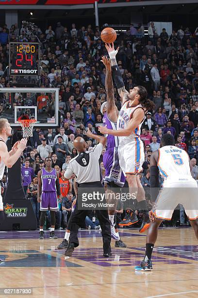 Steven Adams of the Oklahoma City Thunder jumps for the ball against DeMarcus Cousins of the Sacramento Kings on November 23 2016 at Golden 1 Center...