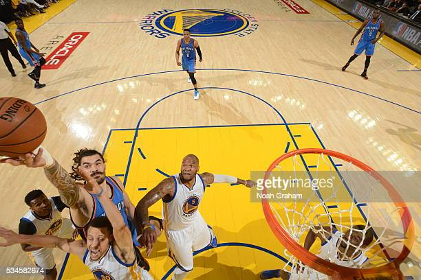 Steven Adams of the Oklahoma City Thunder jumps for the rebound against Stephen Curry of the Golden State Warriors during Game Five of the Western...