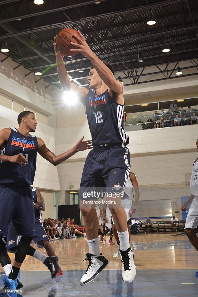 Steven Adams #12 of the Oklahoma City Thunder protects the ball during the 2013 Southwest Airlines Orlando Pro Summer League game between the Oklahoma City Thunder and the Houston Rockets on July 12, 2013 at Amway Center in Orlando, Florida.
