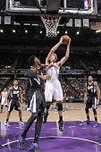 Steven Adams of the Oklahoma City Thunder rebounds against Jason Thompson of the Sacramento Kings on December 16 2014 at Sleep Train Arena in...