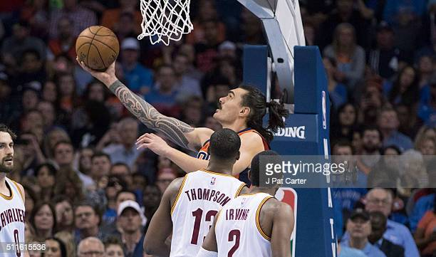 Steven Adams of the Oklahoma City Thunder runs past Tristan Thompson of the Cleveland Cavaliers and Kyrie Irving of the Cleveland Cavaliers for two...