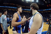 Steven Adams of the Oklahoma City Thunder shakes hands with Linas Kleiza of the Fenerbahce Ulker after their game concluded as part of the NBA Global...