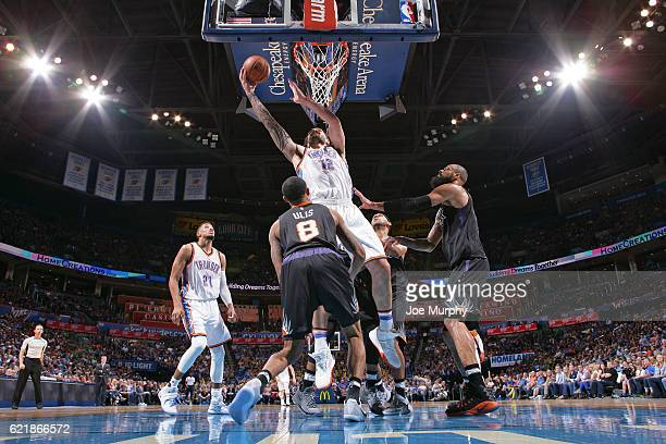 Steven Adams of the Oklahoma City Thunder shoots a lay up against the Phoenix Suns on October 28 2016 at the Chesapeake Energy Arena in Oklahoma City...