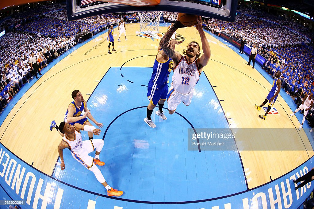 Steven Adams #12 of the Oklahoma City Thunder shoots against Andrew Bogut #12 of the Golden State Warriors in the first half in game three of the Western Conference Finals during the 2016 NBA Playoffs at Chesapeake Energy Arena on May 22, 2016 in Oklahoma City, Oklahoma.