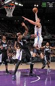 Steven Adams of the Oklahoma City Thunder shoots against Jason Thompson of the Sacramento Kings on December 16 2014 at Sleep Train Arena in...
