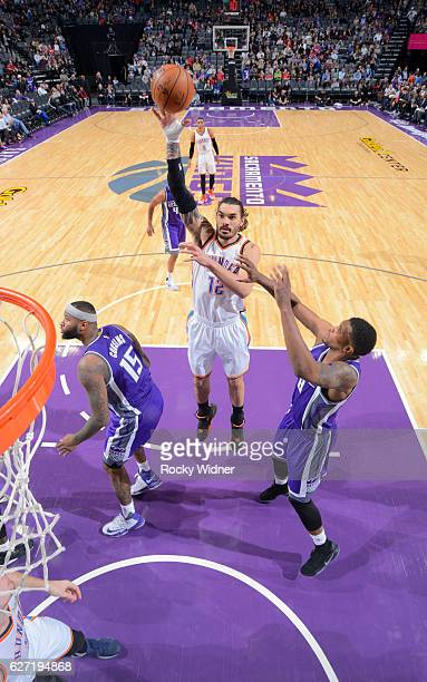 Steven Adams of the Oklahoma City Thunder shoots against Rudy Gay of the Sacramento Kings on November 23 2016 at Golden 1 Center in Sacramento...