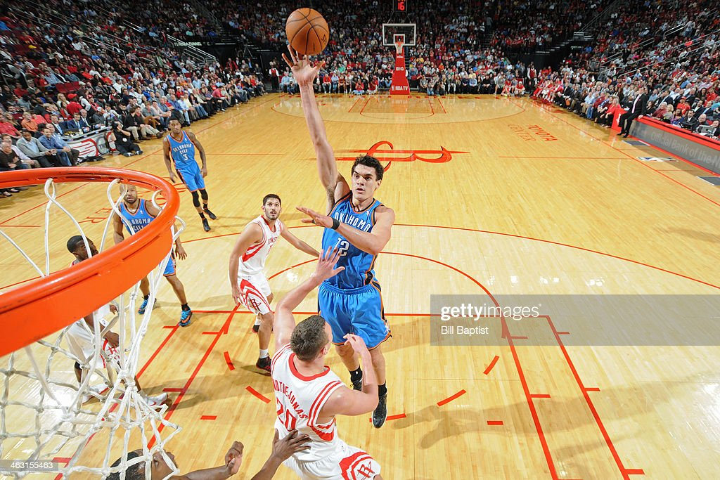 Steven Adams #12 of the Oklahoma City Thunder shoots against the Houston Rockets on January 16, 2014 at the Toyota Center in Houston, Texas.