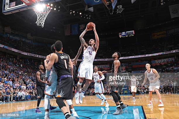 Steven Adams of the Oklahoma City Thunder shoots the ball against the Phoenix Suns on October 28 2016 at the Chesapeake Energy Arena in Oklahoma City...