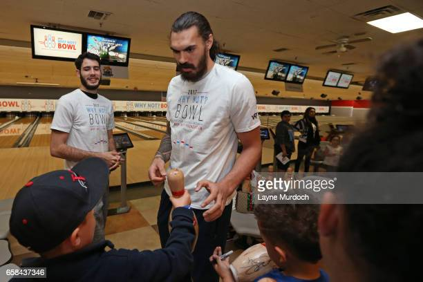 Steven Adams of the Oklahoma City Thunder signs autographs during Russell Westbrook's 7th annual Why Not Foundation bowling event on March 24 2017 at...