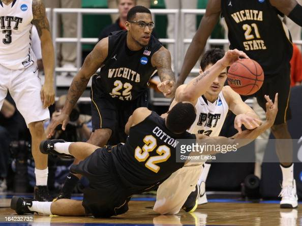 Steven Adams of the Pittsburgh Panthers and Tekele Cotton of the Wichita State Shockers battle for a loose ball in the second half during the second...