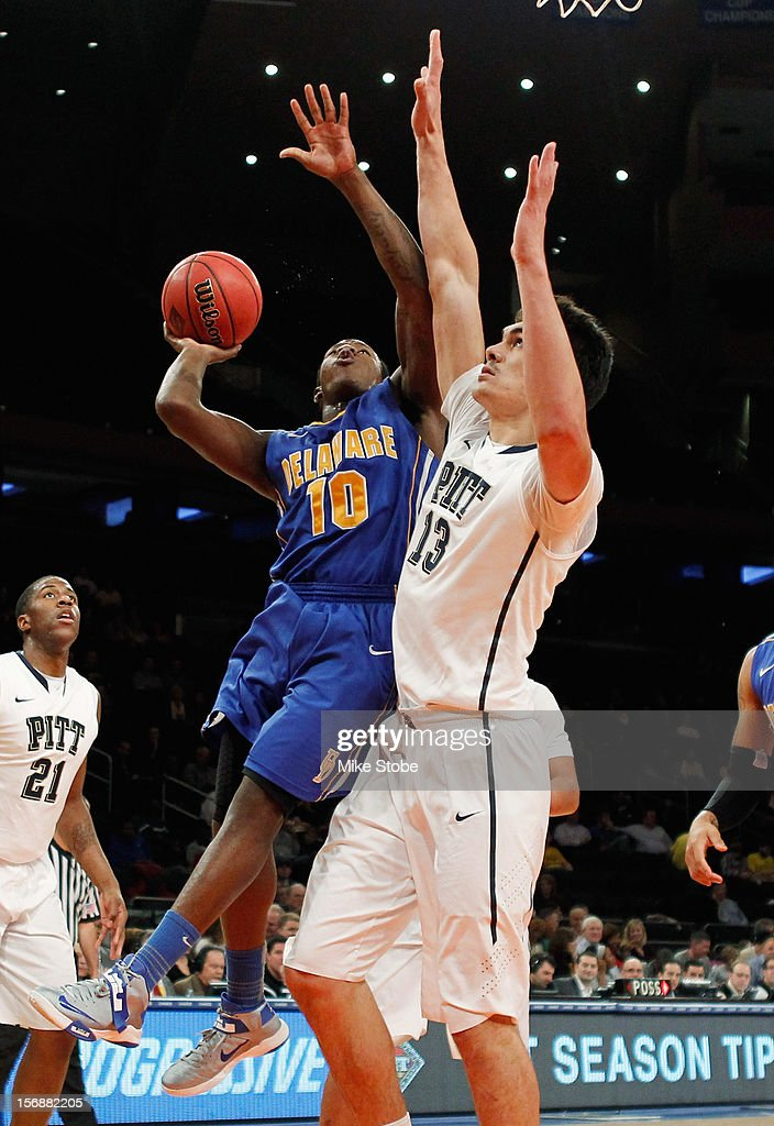 Steven Adams #13 of the Pittsburgh Panthers defends the net against Devon Saddler #10 of the Delaware Fightin' Blue Hens at Madison Square Garden on November 23, 2012 in New York City. Pittsburgh Panthers defeated the Delaware Fightin' Blue Hens 85-59.