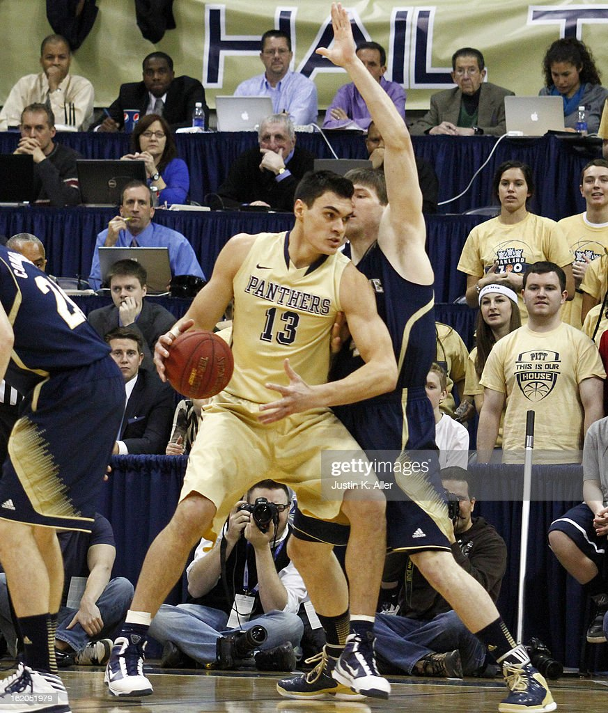 Steven Adams #13 of the Pittsburgh Panthers handles the ball against the Notre Dame Fighting Irish at Petersen Events Center on February 18, 2013 in Pittsburgh, Pennsylvania.