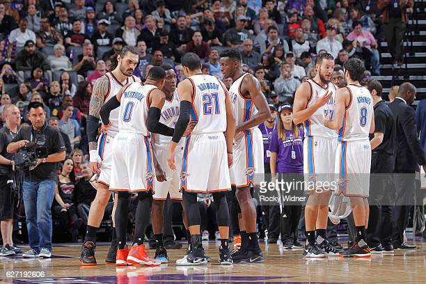 Steven Adams Russell Westbrook Victor Oladipo Andre Roberson and Jerami Grant of the Oklahoma City Thunder huddle up during the game against the...