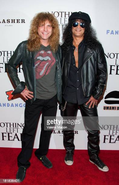 Steven Adler and Slash arrives at the screening of Anchor Bay Films' 'Nothing Left To Fear' at ArcLight Cinemas on September 25 2013 in Hollywood...