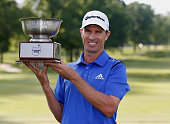 Steven Alker from New Zealand holds up the trophy after winning the Webcom Tour Cleveland Open with a score of 14 and winning on the 11th playoff...