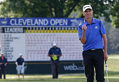 Steven Alker from New Zealand pumps his fist after making a birdie on a tour record 11th playoff hole to win the Webcom Tour Cleveland Open with a...
