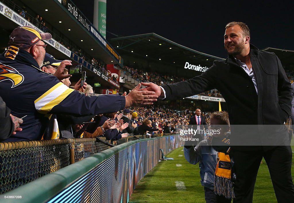 Steven Armstrong walks a lap of honour with team mates celebrating the West Coast Eagles 2006 Premiership anniversary during the round 15 AFL match between the West Coast Eagles and the Essendon Bombers at Domain Stadium on June 30, 2016 in Perth, Australia.
