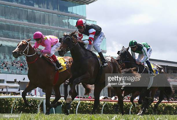 Steven Arnold riding Direct Charge wins race one the Hong Kong Jockey Club Maribyrnong Plate during 2012 Emirates Stakes Day at Flemington Racecourse...