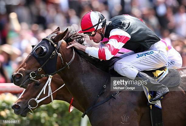 Steven Arnold riding Direct Charge wins the Hong Kong Jockey Club Maribynong Plate during 2012 Emirates Stakes Day at Flemington Racecourse on...